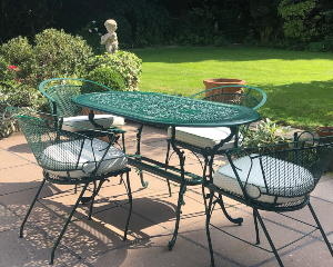 Green table and chairs after refurbishment
